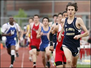 Greg Turissini of St. John's wins the 1600 meter run during the City League track meet.