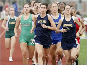 Front Francesca Veluscek, left, and Lauren Duncan, right, of Notre Dame lead the pack in the 1600 meter run during the City League track meet. Lauren Duncan finished first and Francesca Veluscek placed second.