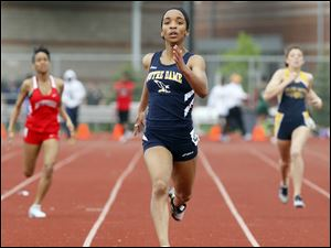 Kaila Gardner of Notre Dame wins the 400 meter dash during the City League track meet.