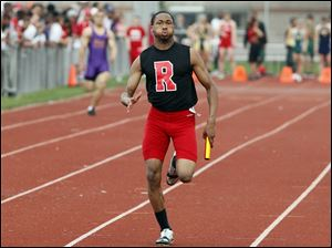 Allan Forrest of Rogers wins the  final leg of the 4x200 meter relay during the City League track meet.
