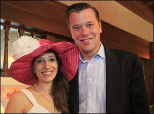 Erin, left, and Jarrod Hirschfeld at the Sylvania Country Club's Derby Day party.