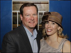 Jeff Morris and Valeka Riegel enjoy the Kwinnas Derby Party at the Toledo Club.