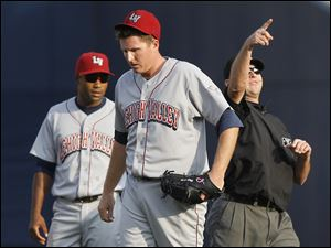 Lehigh Valley IronPigs pitcher Eddie Bonine, center, is ejected from the game by third base umpire Chris Ward for arguing a call while teammate Josh Barfield looks on during the first inning against the Toledo Mud Hens.