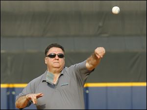 Toledo Blade sports editor Frank Corsoe throws out the first pitch before the Toledo Mud Hens play the Lehigh Valley IronPigs at Fifth Third Field.
