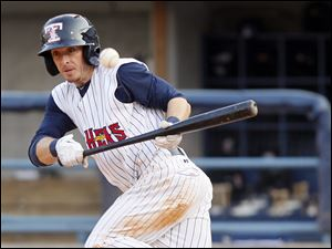 Toledo Mud Hens player Will Rhymes bunts safely against the Lehigh Valley IronPigs during the fourth inning.