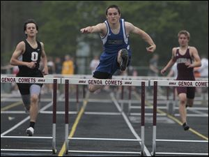 Elmwood's Joe Pritts, center, wins his heat in the 300 meter hurdles during SLL track meet.
