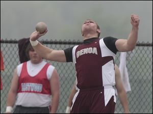 Genoa's Brad Szypka throws in the shot put finals during SLL track meet.