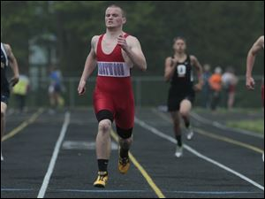 Eastwood's Zach Conkle, second from left, wins his section in the 400 meter dash at the Suburban Lakes League track and field meet.