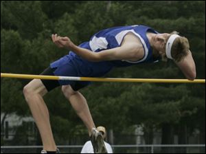 Elmwood's Kyle Smithey clears the pole to win the high jump during SLL track. He won the event with a jump of 6 feet, 1 inch.