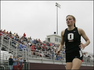 Otsego's Kylee Bernthisel competes in the 1600 meter run during the Suburban Lakes League track and field meet.