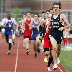 Greg Turissini of St. John's wins the 1600 meters to help the Titans claim the City League title. Turissini won the 1600 with a time of 4:23.40 and the 3200 in 9:43.79 to help the Titans nip Whitmer.