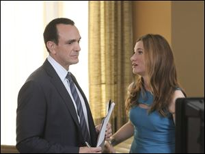 Hank Azaria plays Alex and Kathryn Hahn is Helen in the comedy 'Free Agents.'