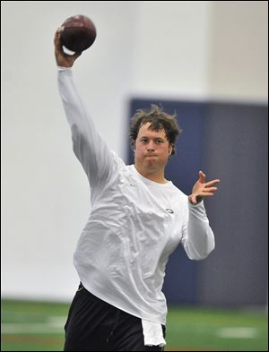 Lions' quarterback Matthew Stafford, one of about 30 Detroit players that showed up to practice voluntarily Monday at Detroit Country Day School during the lockout, says his repaired shoulder in healthy after surgery in January.
