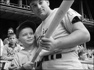 Minnesota Twins' Harmon Killebrew  posing with 9-year-old Johnny Guiney, at New Yorks Yankee Stadium.  Killebrew, the Twins slugger known for his tape-measure home runs, died Tuesday, May 17, 2011, at his home in Scottsdale, Ariz. He was 74.