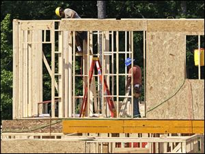 Construction of new U.S. homes dipped slightly last month, missing expectations, in a sign that the building industry's recovery from the housing bust is likely to be bumpy and gradual.