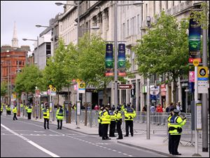 Irish Police secure the area in O'Connell Street in central Dublin, Ireland, on Tuesday ahead of Britain's Queen Elizabeth II's four-day visit, the first visit by a British Monarch in nearly 100 years.