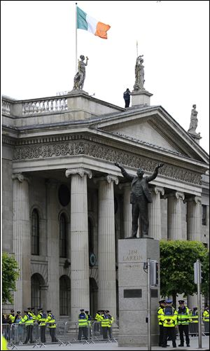 The Irish tricolor flies over the General Post Office, one of the major sites of the 1916 Easter Uprising against British Rule, in the center of Dublin, Ireland. The statue is to Irish trade union leader Jim Larkin.