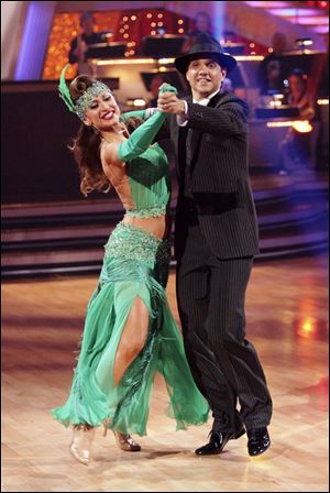 Actor Ralph Macchio, right, and his partner Karina Smirnoff were voted off 'Dancing With the Stars' Tuesday night.