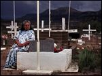 Therlene Ramos visits the grave of her son, Sam Ybarra, at a cemetery on the San Carlos Apache Reservation in Arizona. After returning from Vietnam, Ybarra drank for days at a time.  `He was alive, but dead,' she said.