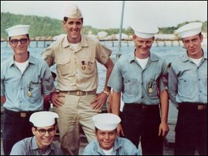 Democratic presidential candiae John Kerry is with his shipmates in 1969. As a Navy lieutenant, Mr. Kerry skippered a 'Swift' boat that patrolled the Mekong River.