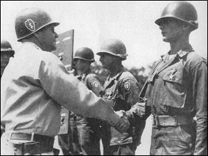 As a young officer, David Hackworth receives the Silver Star from Gen. Omar Bradley for heroism under enemy fire in Korea on Feb. 6, 1951.