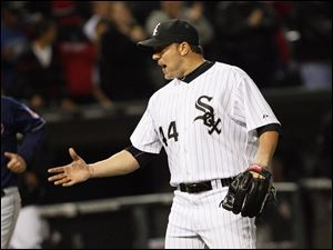 Chciago White Sox' pitcher Jake Peavy reaches to shake hands with catcher AJ Pierzynski after throwing a complete game three-hitter to  defeat the Cleveland Indians.