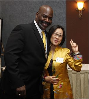 Mayor Mike Bell, shown with Chinese investor Yuan Xiaohona, says Toledo is open for business.