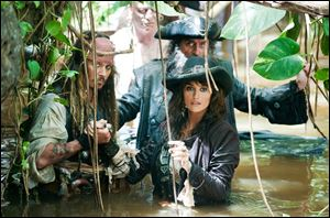 Johnny Depp, left, Penelope Cruz, right, and Ian McShane are shown in a scene from 'Pirates of the Caribbean: On Stranger Tides.'
