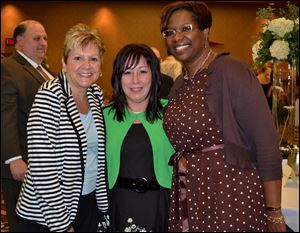 From left, MaryBeth Zolik, Amy Weemes, and Lisha Washington at the 18th Annual Mom's Night Out gala.