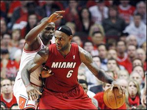 Miami's LeBron James drives against Chicago's Luol Deng Wednesday night in Game 2 of the Eastern Conference finals. The Heat won 85-75 to tie the series heading back to Miami for Game 3.
