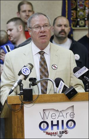 Toledo city councilman D. Michael Collins speaks at an rally against Ohio's new collective bargaining law.