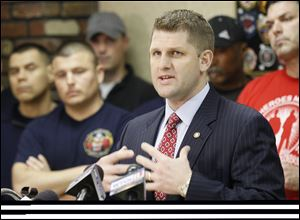 State Rep. Matt Szollosi speaks against Senate Bill 5 and Ohio Gov. John Kasich during a news conference Thursday at the Toledo Firefighters Local 92 union hall.