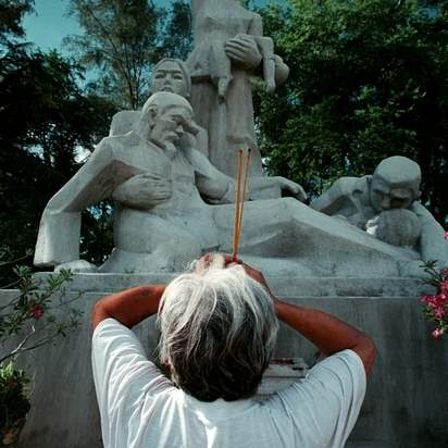 Vo-Van-Sac-60-burns-incense-and-prays-in-front-of-the-memorial-at-My-Lai