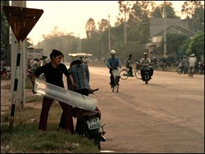 August 3, 2003-- Ice is delivered on the back of a motorbike in Quang Ngai City at a little after 5 o'clock in the morning. The days begin early in Quang Ngai City like the rest of Vietnam.
