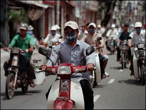 August 3, 2003-- With a population of over three million people, Saigon, or Ho Chi Minh City as it's officially called, is loaded with motorbikes.