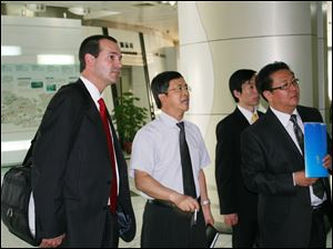 Dean Monske talks with businessmen in China at Shenzhen High Tech Industrial Park.