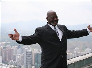 Toledo Mayor Mike Bell atop the Empire Building in Shenzhen, China.