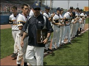 Whitmer head coach Gary O'Connor holds the runner-up trophy after the Panthers were defeated by St. John's.