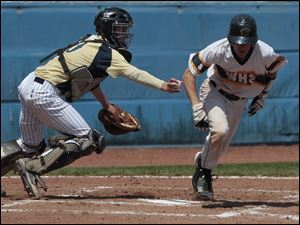 St. John's catcher Corey Tipton tags out Whitmer's Tyler LaFountain on a strikeout.