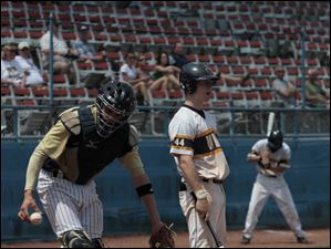 St. John's catcher Corey Tipton handles the ball after Whitmer's Jack Linch strikes out to make the final out during district final.