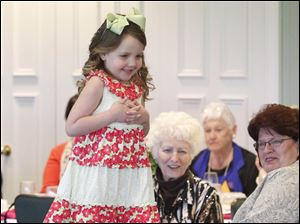 Ella Rau, 5, models a flower print dress at Inverness Club.
