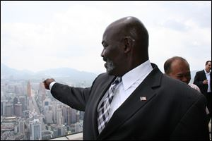 Mayor Mike Bell, wearing an American flag pin on his lapel, takes in a view of the city of Shenzhen, China, from atop the Empire Building as the mayor and other local officials began to form relationships with Chinese businessmen.