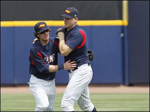 Mud Hens second baseman Will Rhymes makes a catch of Che-Hsuan Lin's fly ball, and is able to hold on as he is run into by teammate Scott Thorman.