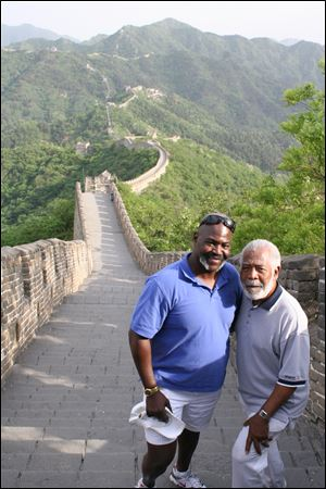 Toledo Mayor Mike Bell, left, and his father, Norman, stand on of the Great Wall of China.