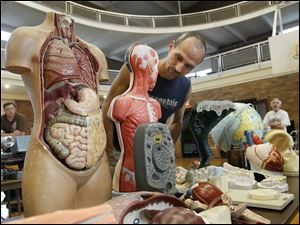 Jim Schaffer of Monroeville, Ohio, looks at some of the science items that are up for auction at Libbey High School.