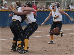 Notre Dame catcher Bitty Treece runs into the arms of pitcher Cassie Gillespie after they defeated Central Catholic during city league softball championship game.