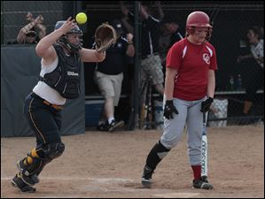 Notre Dame catcher Bitty Treece throws up the ball and glove after the last Central Catholic batter Morgan Steck strikes out.
