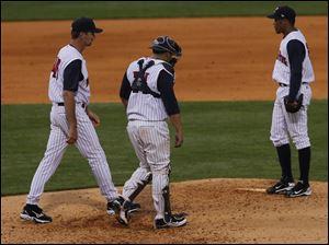 Pitching-coach-catcher-pitcher-Mud-Hens.jpg