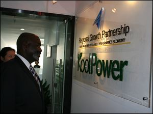 Toledo mayor Mike Bell visits KoolPower, of the Regional Growth Partnership, in China.