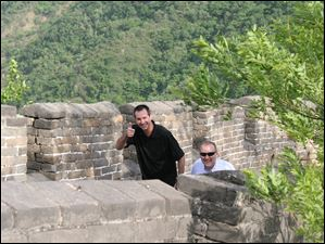 Dean Monske, left, president of the Regional Growth Partnership, and Scott Prephan, of Dashing Pacific Group Ltd., walk on top of the Great Wall of China.